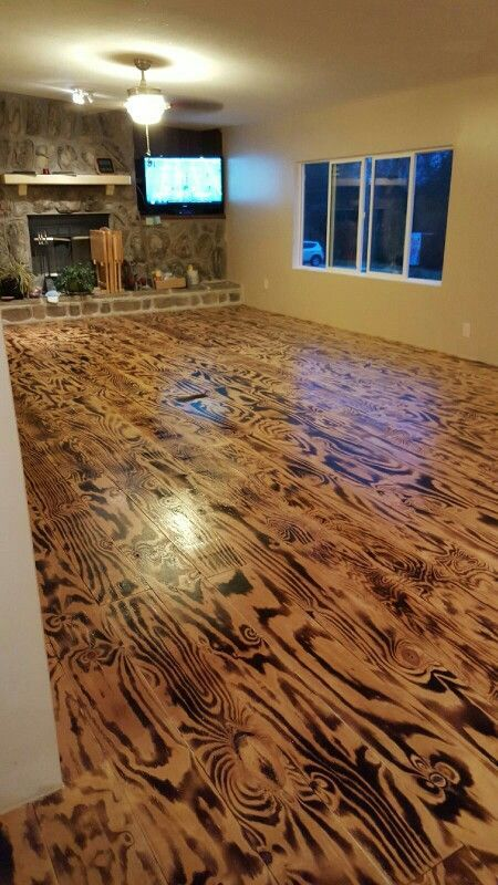Hubby n i made these floors out of plywood n a torch for Unusual inexpensive flooring ideas