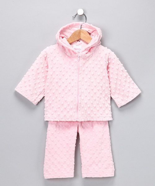 This plush set features textured chenille fabric that introduces tiny hands to the world of touch.The comfy elastic waistband on the pants and the smooth zipper on the hoodie mean this snuggly outfit is easy to slip on too!Includes hoodie and pants100% polyesterMachine wash; tumble dry
