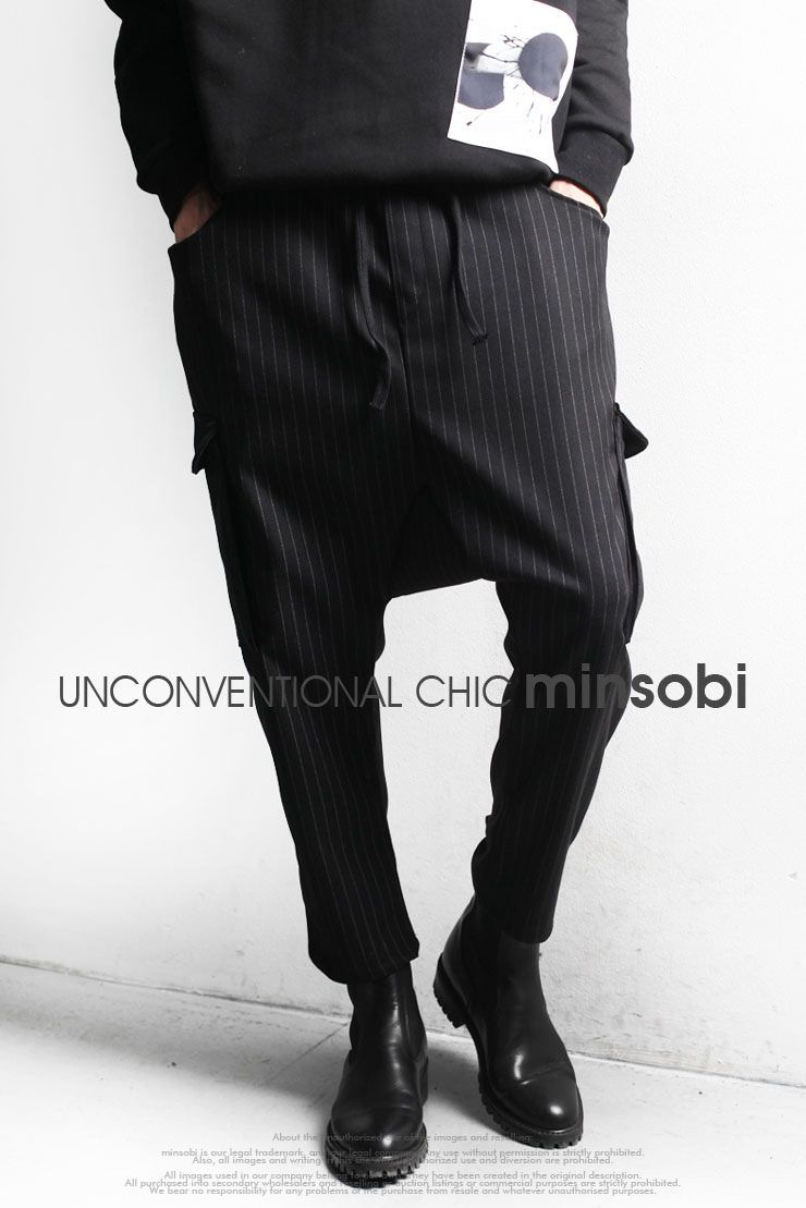Mens wide gaucho pants with classy pinstripes. Easy pants made of cotton fabric for the right occasion.