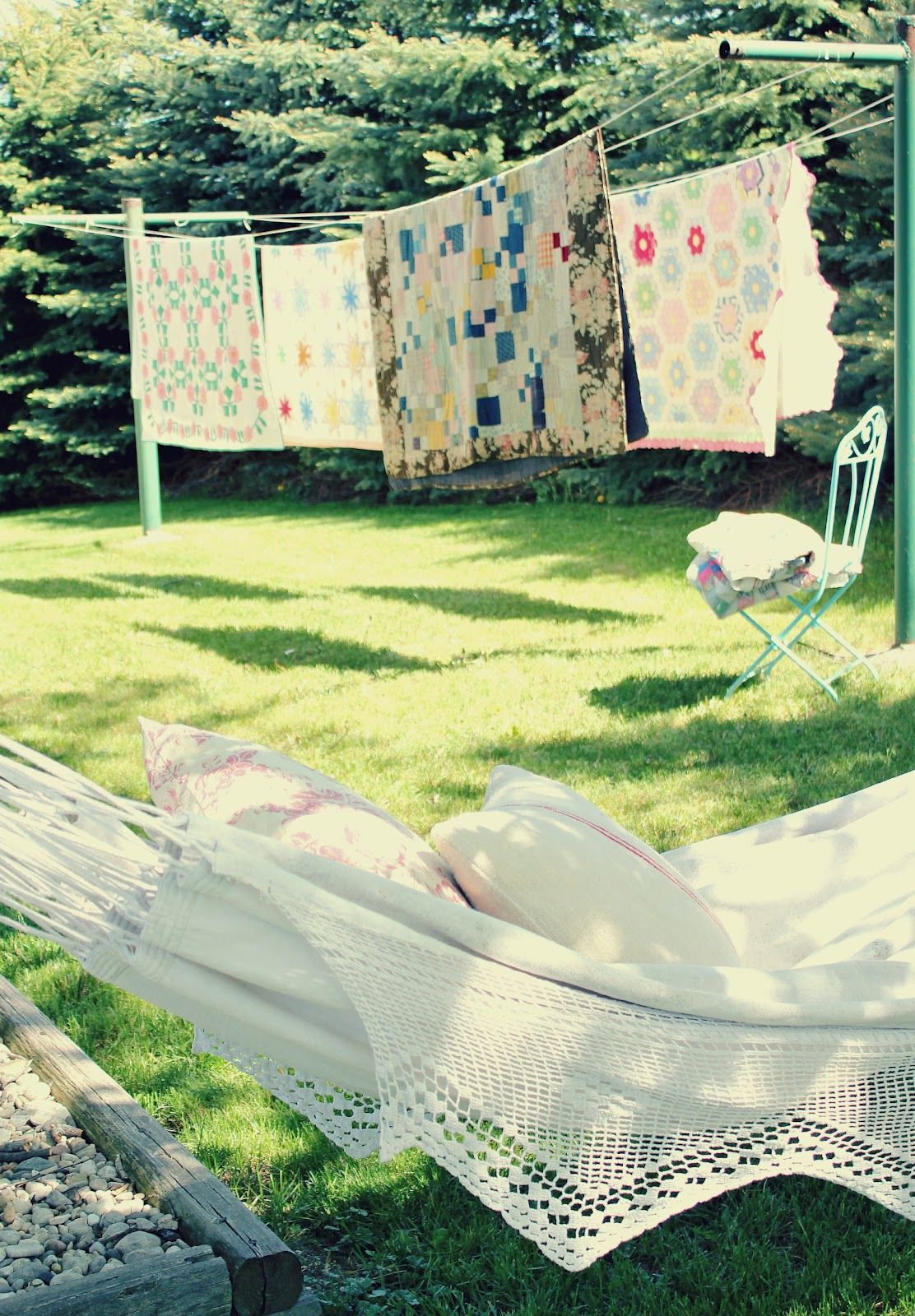 quilts blowing in the sunny breeze--a hammock to nap on