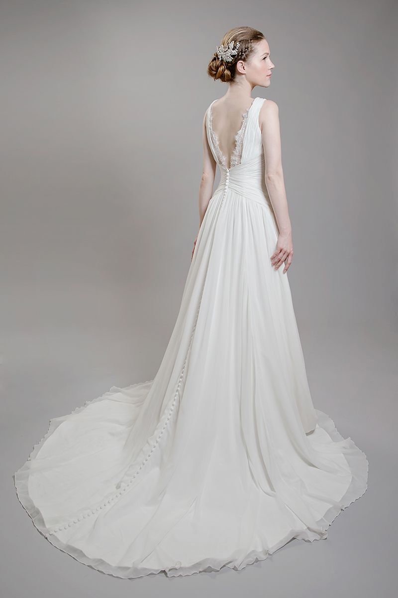 This elegant, strapless velvet chiffon gown is soft and flirty. Ruching on bodice and waist results in the ultimate in figure flattery. A line gown features intricate beading. Vintage lace and chiffon fabric shapes a soft silhouette for added romance. Chapel train. Available in IVORY only. Franssical | F1604