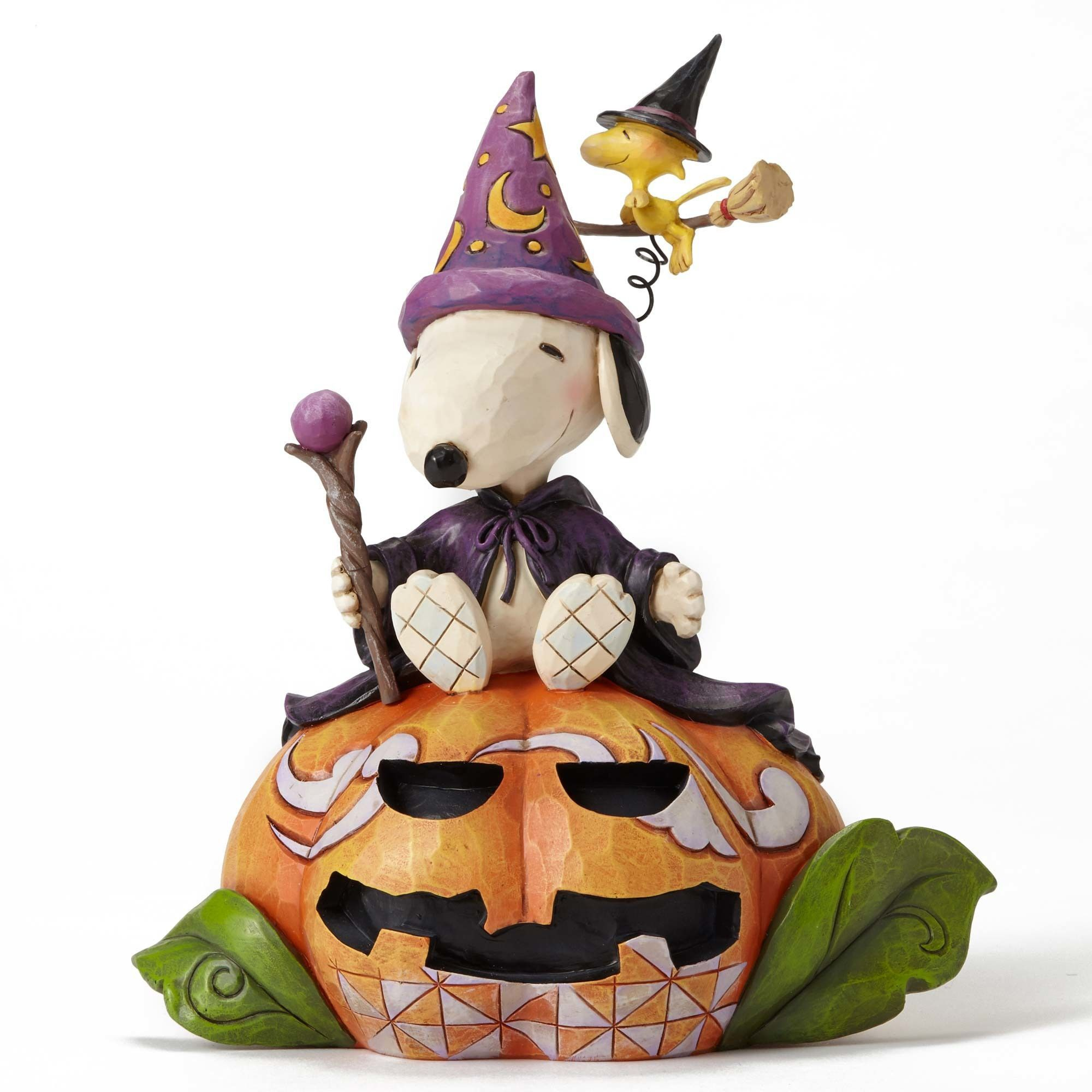 Item Number: 4052724 Material: Stone Resin Dimensions: 7.4 in H x 4.72 in W x 6.3 in L Wizard Snoopy along with Flying Witch Woodstock rest atop a jack-o-lantern in this colorful Halloween design feat