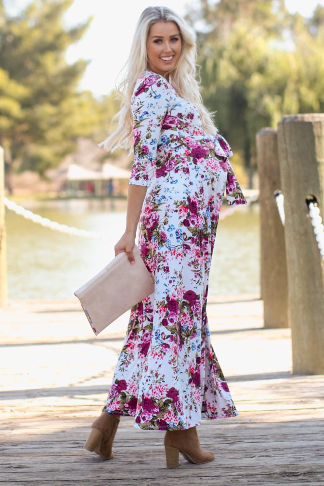 91b2a15d09d A floral print maternity maxi dress. V-neckline. Perfect for nursing after  pregnancy. Cinched under bust. Sash tie. 3 4 sleeves.
