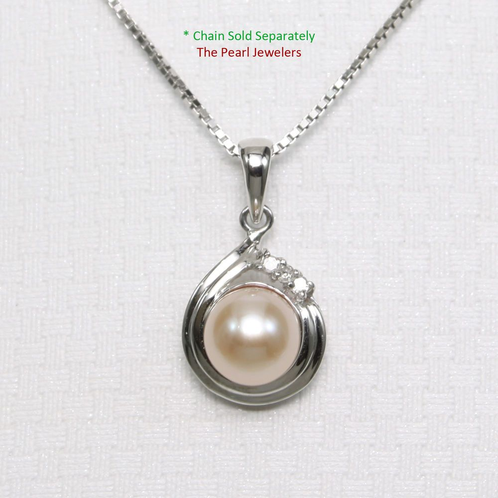 Genuine pink cultured pearl pendant set in k white solid gold with
