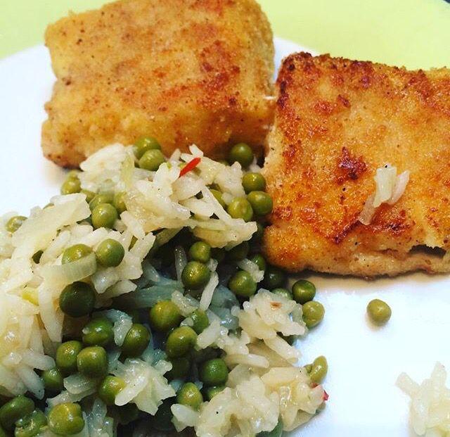 Homemade fish sticks of cod fish, white rice with peas.