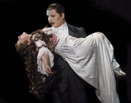 Hahaha so, in the London version, he picks her up like this when she faints, but in the Broadway version, he lets her fall and just puts his cape on her. Something about American actor's safety rights. Michael Crawford had a hernia when he was in the show in NYC, probably because of this, so it was changed. But the London phantoms still have to work out :)