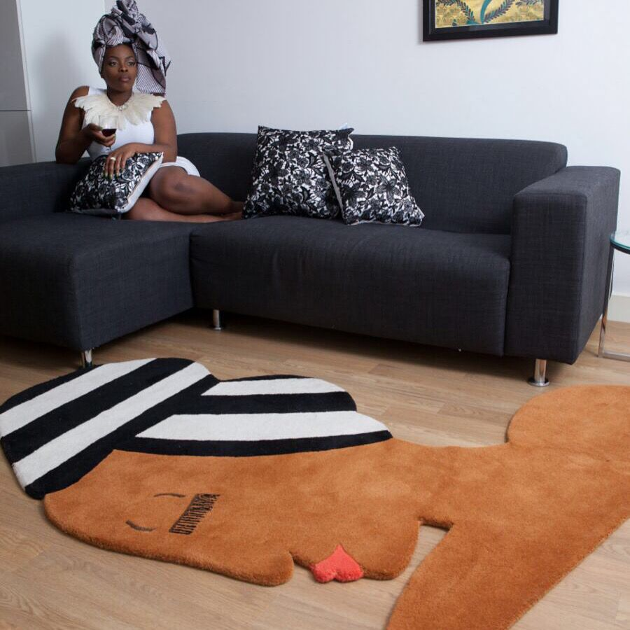 Erykah   Make a statement all year round with this bold and beautiful rug made from pure Indian wool. People of various cultures and backgrounds wear Head-wraps and this design is a celebration of natural style icons who make fashion statements all over the world. The Erykah rug is inspired by Erykah Badu, Queen of Neo Soul who was known for championing unique towering headpieces.