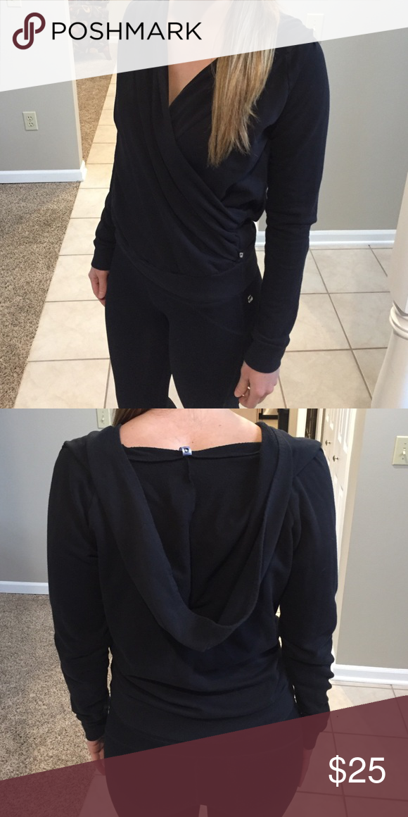 Fabletics crossover hoodie Size small, black hoodie. Crossover in the front. Cute and comfy! Fabletics Tops Sweatshirts & Hoodies