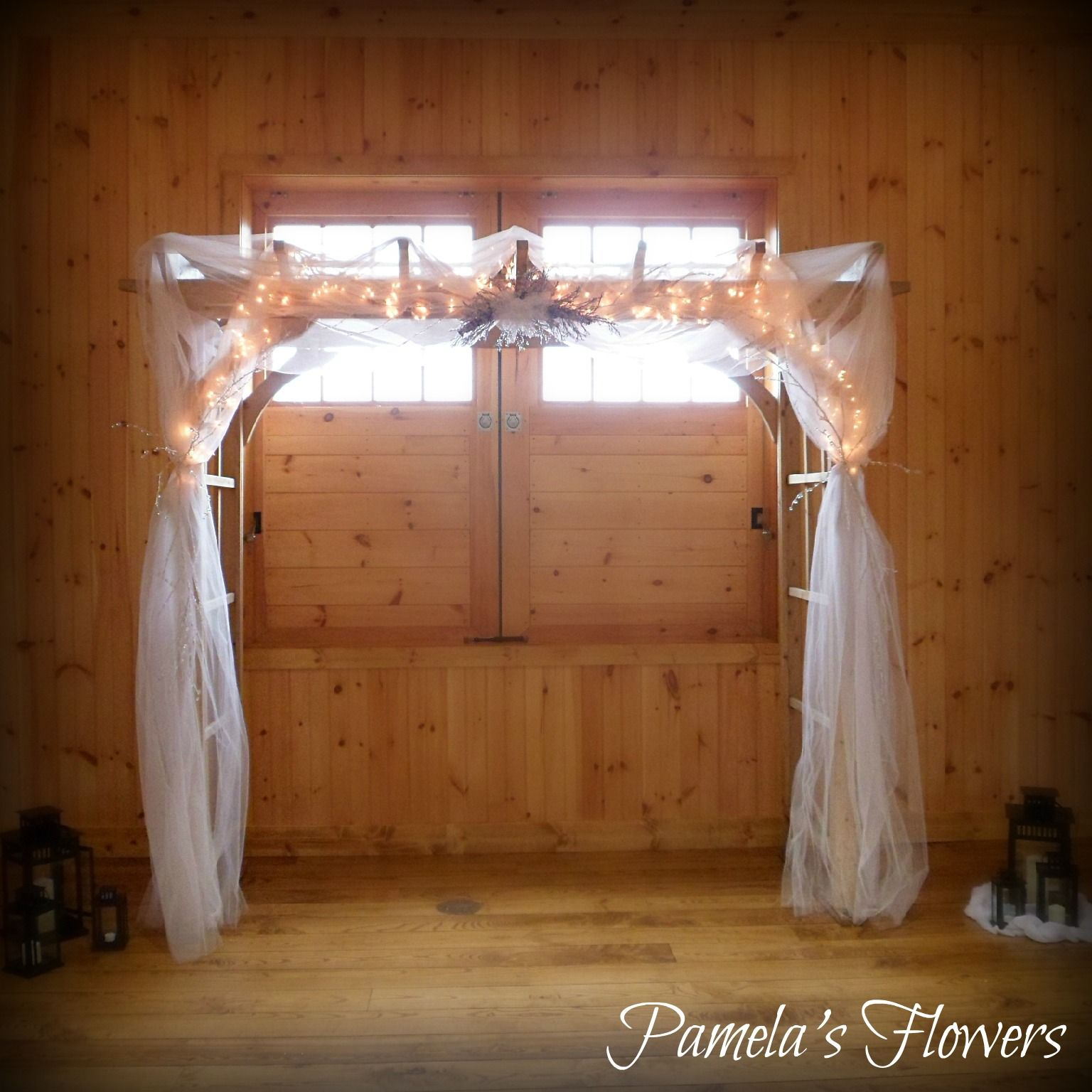 Archway Decorated by Pamela's Flowers ~ Archway at Ironstone Ranch decorated with white tulle, white lights, a swag of crystal branches, and beaded crystals and branches draped among the tulle. ~ Find us online at www.pamelasflowers.com