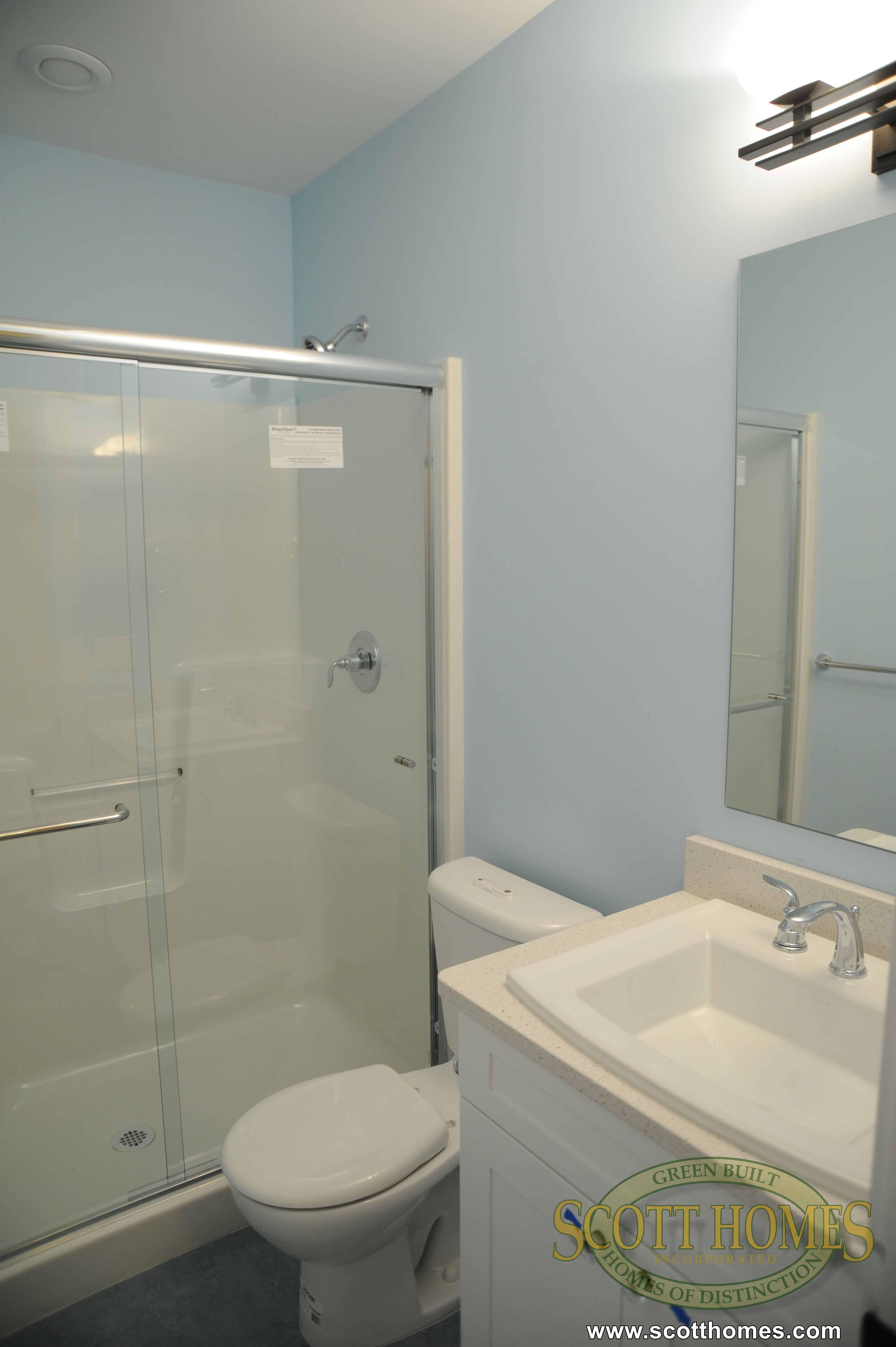 This bathroom has a walk-in shower and one large sink, perfect for guest.