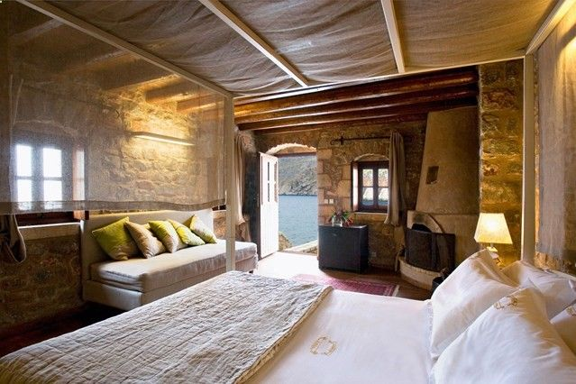 Rooms have wooden beams and exposed stonework, and many of them overlook the sea