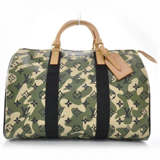 466d19713c289 This is an authentic LOUIS VUITTON Monogramouflage Speedy 35 LE. This  stylish tote is beautifully crafted of Louis Vuitton black monogram on  green and ivory ...