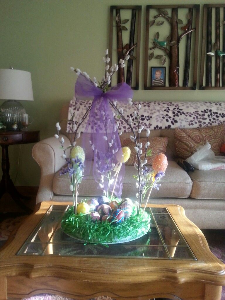 I used a round Styrofoam and hot glued paper grass to it and attached it to plastic charger  plate with glue dots.  Add pussywiilows and secured top center with a sheer bow.  Accented with flowers, sparkly foam eggs and decorative Easter Eggs placed on center plate.