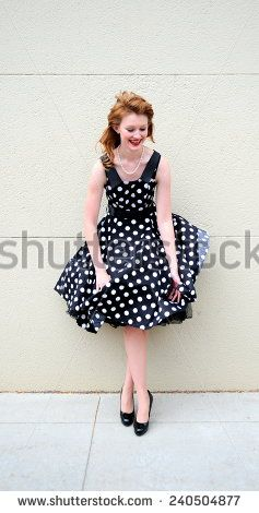 Female fashion model having a dress malfunction outdoors.