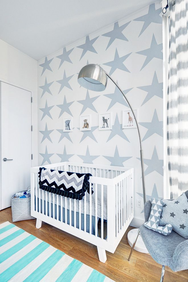 Baby boy's room in soft blues and bold patterns.