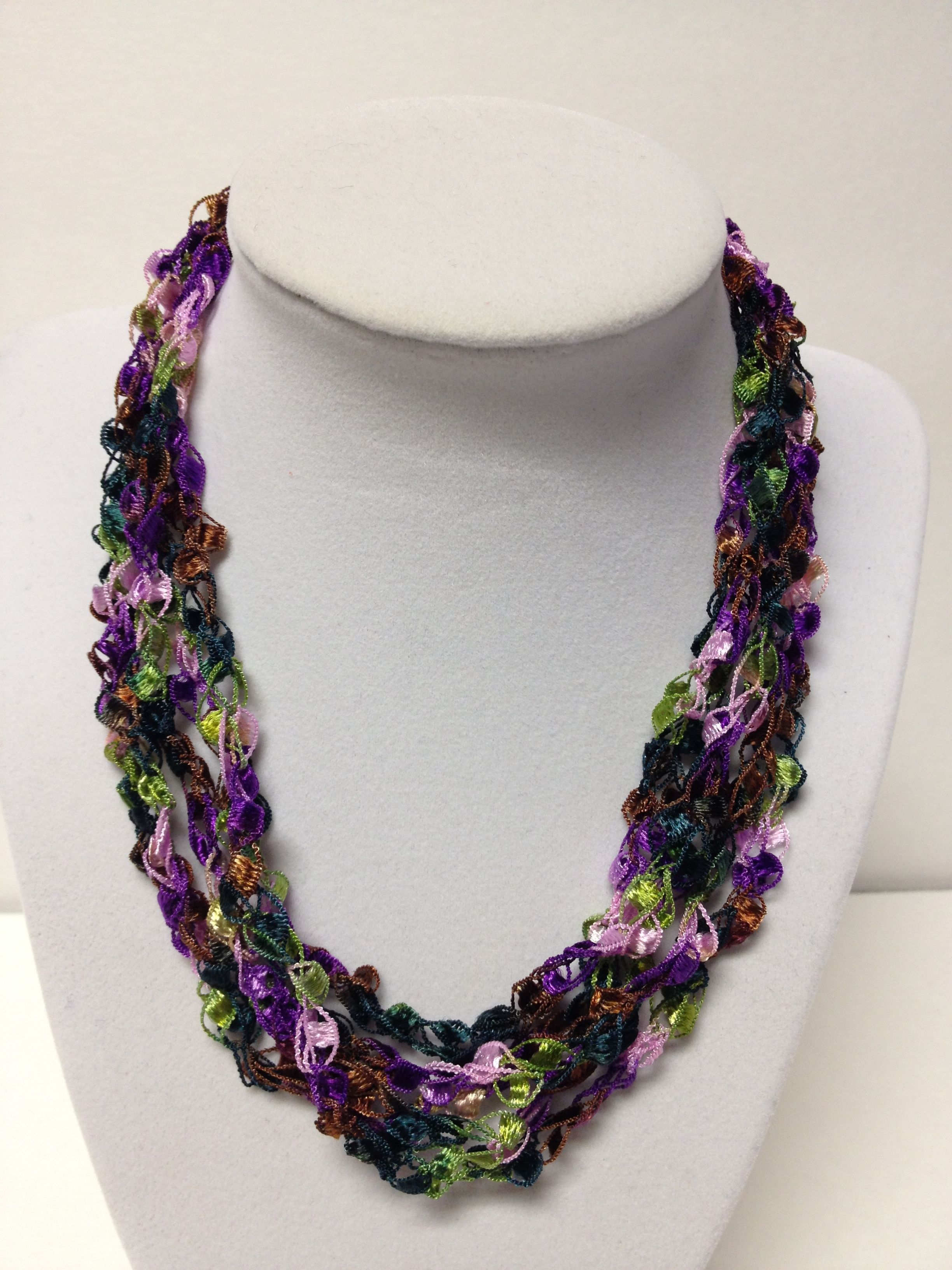 "Check my blog: centraltexascrafter.com or direct link below. Want the look of beads but enjoy the light-weight feel of yarn?Handcrafted, gorgeous flower garden collection of pink, purple and green necklace - I absolutely love this combination!  Length can be adjusted from 18"" to 24"" with ease. No metal, no clasps - easy to put on and wear. You'll get so many comments on your ""beads"" - this unique necklace will garner you many compliments!"