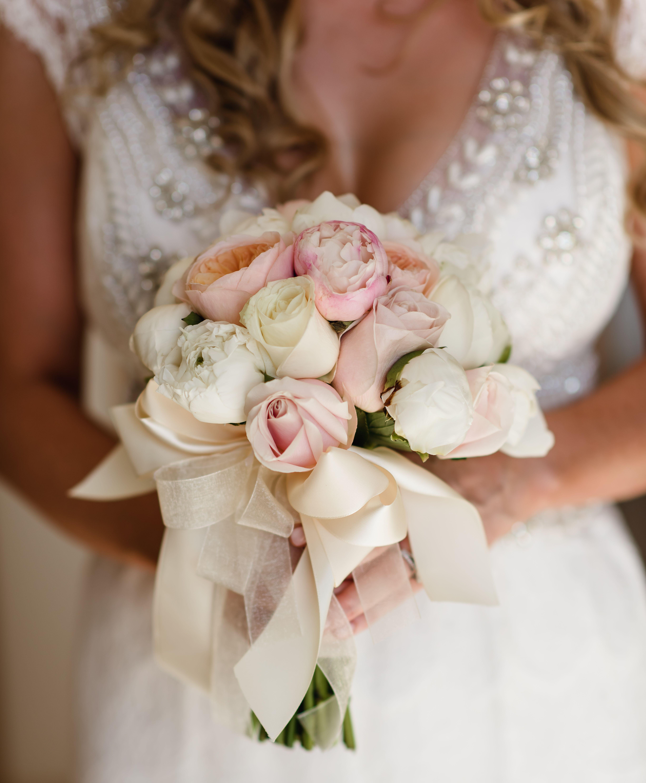 A Bouquet Of Pastel Flowers To Underline Your Attire