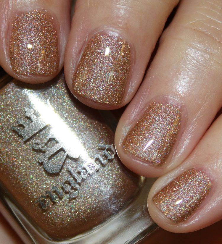 a-England Heavenly Quotes Collection | Vampy Varnish / Sparks Divine is a light antique gold/beige with holographic shimmer