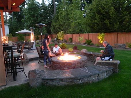 Round Concrete River Rock Seating and Round Fireplace and Bar Stools