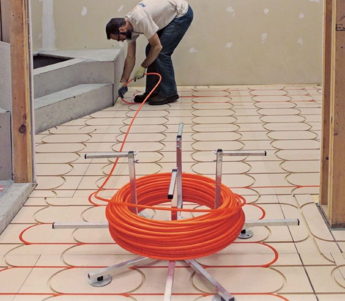 Radiant Floor Heat Smarttrac Is A Non Structural Modular Panel System Designed To Simplify Radiant Heating Radiant Heat Radiant Floor Radiant Floor Heating