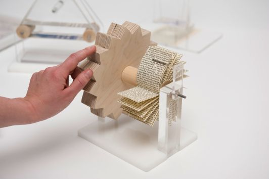 Gabriele Meldaikyte is a student at London's Royal College of Art. As a master's project, she created Multi-Touch Gestures, which captures the physical movements behind the iPhone's famous gestures in a series of quirky, mechanical machines built from acrylic and wood.