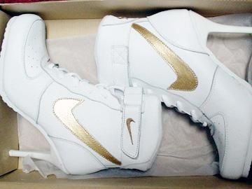 I like how the gold nike sighn makes the white color shimmer soo cute