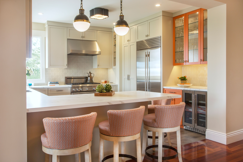 bright orange cabinetry and designer backsplash tilebd