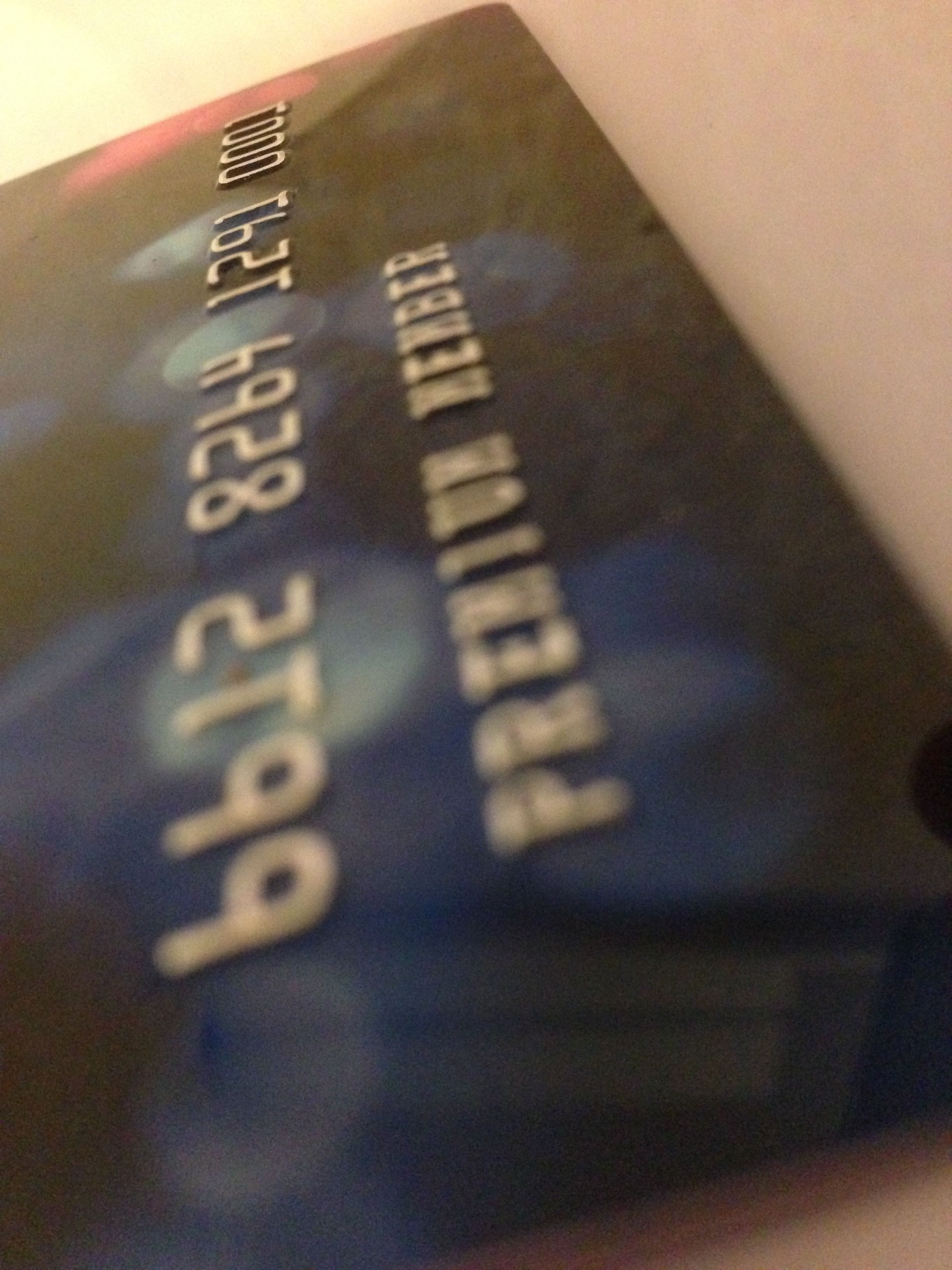 Embossed plastic card with silver tipping plastic card