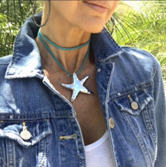 This beach inspired cool choker necklace is made of soft genuine leather cord or vegan faux suede and features a large silver starfish. A fun statement necklace!   SIZE The starfish charm measures 2.25 inches long (56mm). The leather cord measures 36 inches long. Send us a note at checkout if you would like a different length.  ```````````` Choose your Leather or Vegan Faux Suede color: (see last image above)  Genuine Leather Color O...