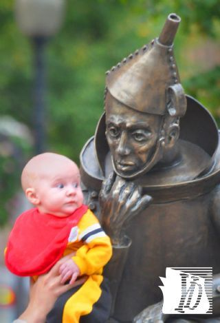 Mark and Randi Becker of Pittsburgh brought their 4-month-old son London to visit family in Glen Rock Sunday, October 7, 2012 and to pose with theTin Man sculpture by Lorann Jacobs. Jacobs' statue is one of six large pieces recently installed in the city, and the Tin Man is special to the Beckers.