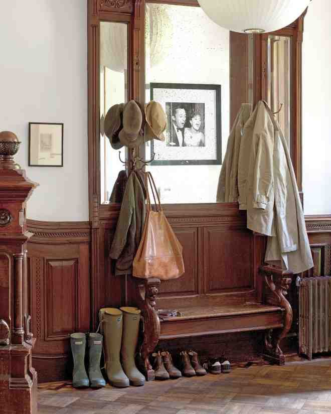 """Coats and bags are hung in the entryway; lacking a front closet, the area can become a """"towering inferno,"""" Pilar says. On the opposite wall is a photo of Pilar's parents, taken by paparazzi (her father was a director and producer; her mother an actress and singer)."""