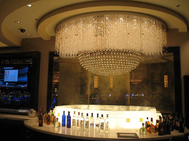 An immense chandelier hangs over one of the Horseshoe\'s fancy bars ...