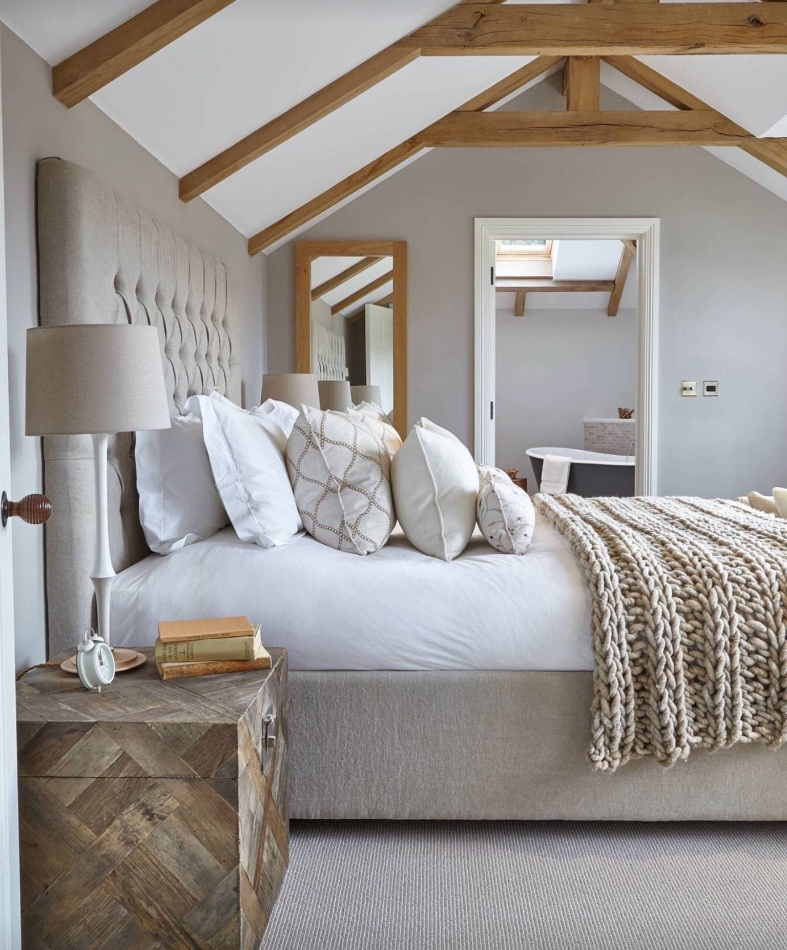 Too Many Pillows, But I Like The Colors And The Wood Beams