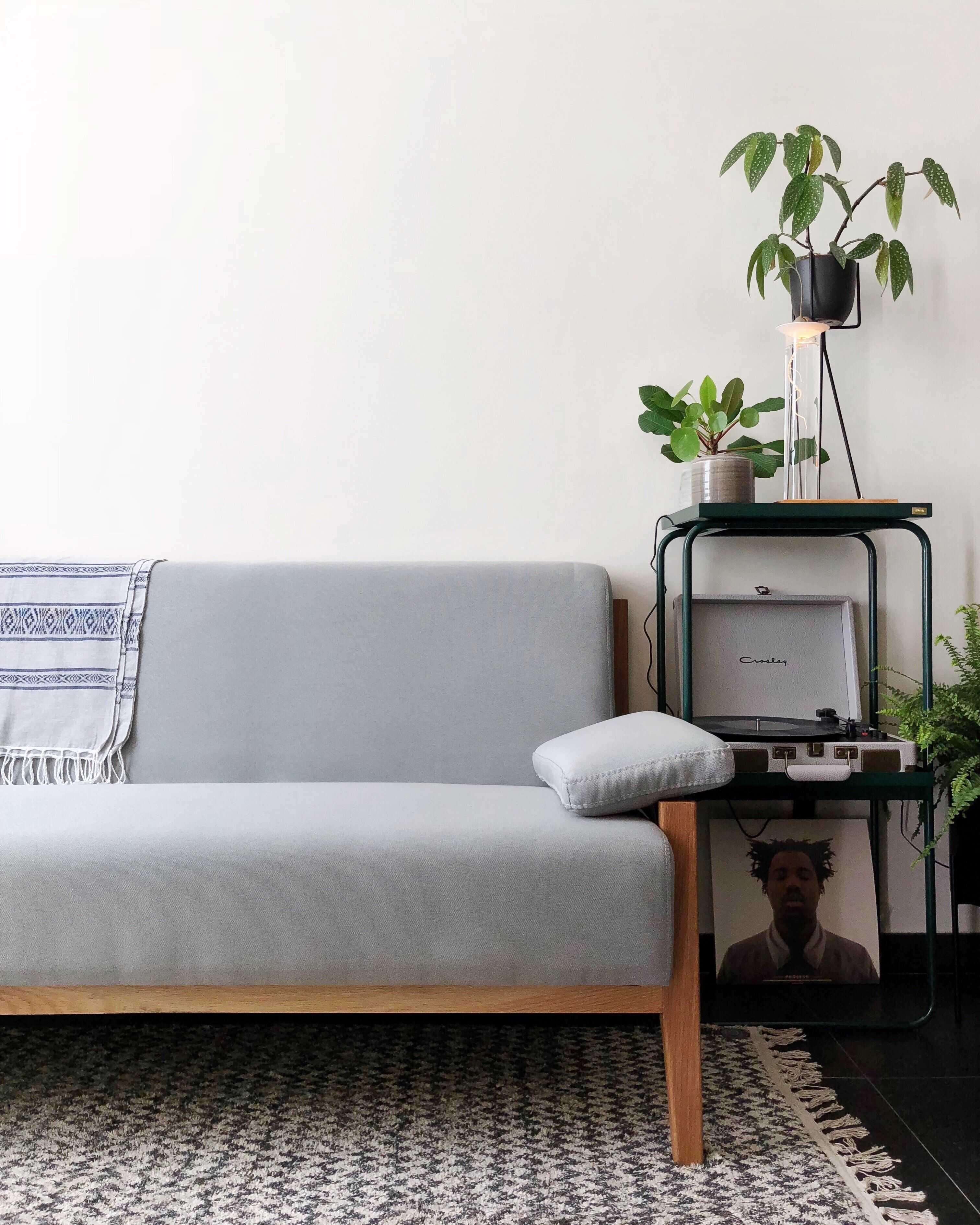 Simple And Light Grey Couch Made Of Fabric And Natural Oak In A Beautiful Combination With Plants Styled By Nelplant