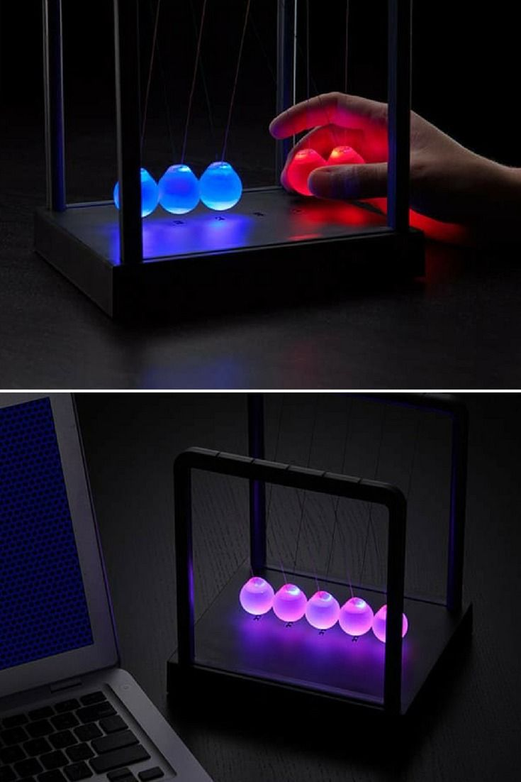What you're looking at is anew version of the Newton's Cradle, upgraded with colorful LEDs. What's cool is the orbs don't just light up, they detect when they're clacking against others and change colors when they hit. It's even more mesmerizing than the original. Here, check it out…  ht #Concept #Desklamp #Lamp #Led #Lighting #Lightingdesign #Modernlighting