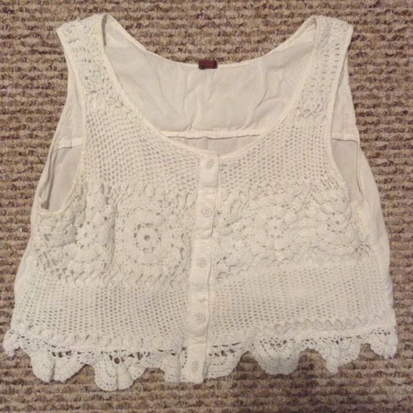 White crochet crop top Adorable white crop top with crochet detailing. Button down front. Lined for extra coverage. Great condition! Cotton. Put in urban outfitters for exposure Urban Outfitters Tops Crop Tops