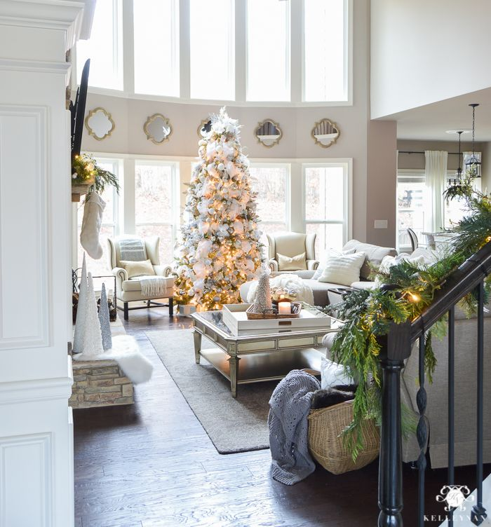 elegant-two-story-great-room-with-christmas-tree-in-front-of-windows ...
