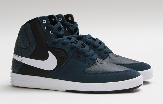 The latest for the current Nike SB Nike SB Paul Rodriguez 7 High is a high  cut edition that is dressed in a mix of dark blue, white and black. The  sneaker'