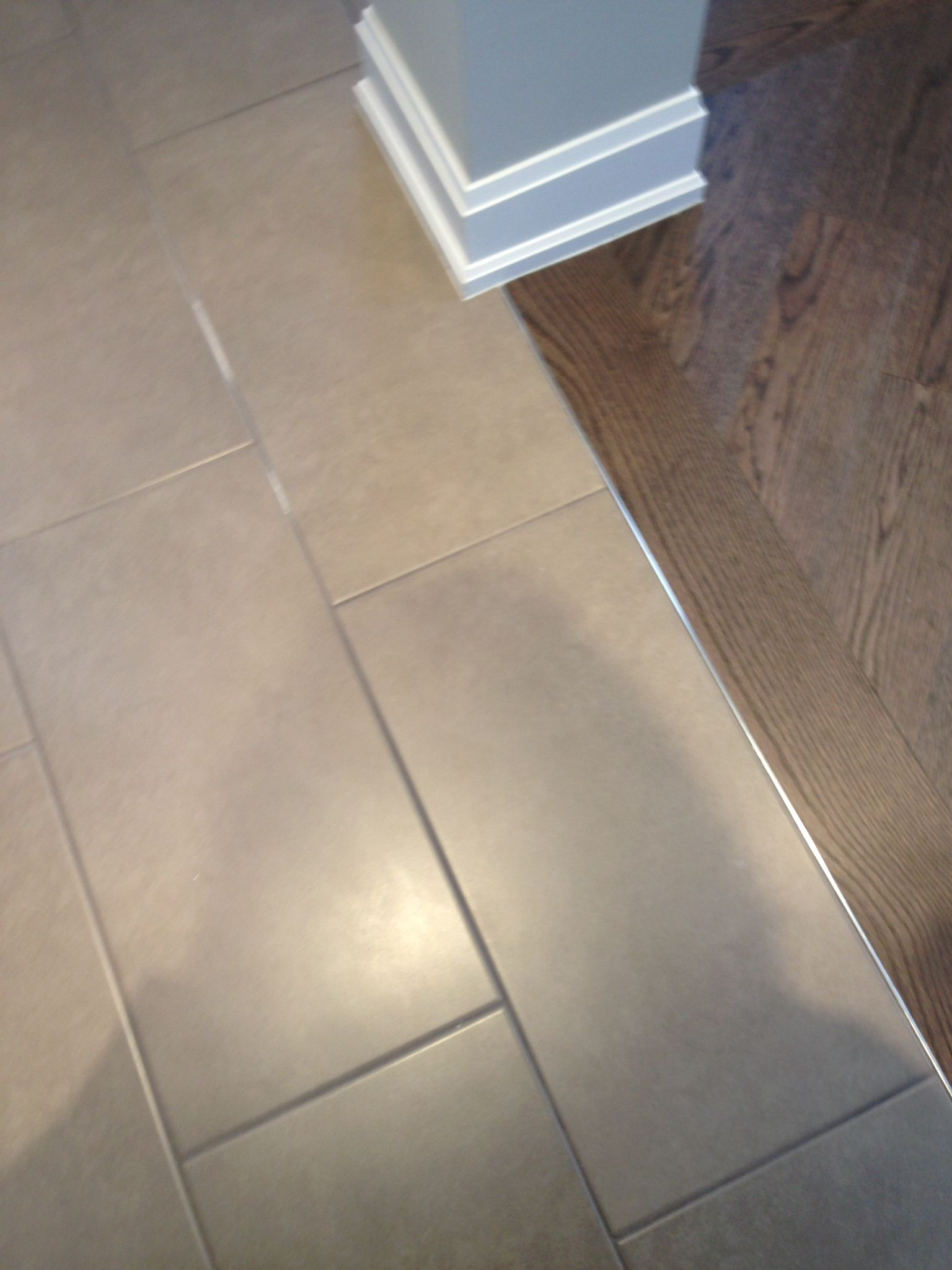 12x24 Kelly Grey Tile From Olympia Tile Installed In A Brick Pattern Nice Size Thinking Floors Bathroom Floor Tiles Tiles Grey Tiles