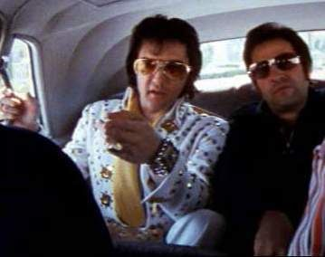 Elvis and Joe in the backseat of the limo after Elvis Jacksonville concert in april 16 1972.