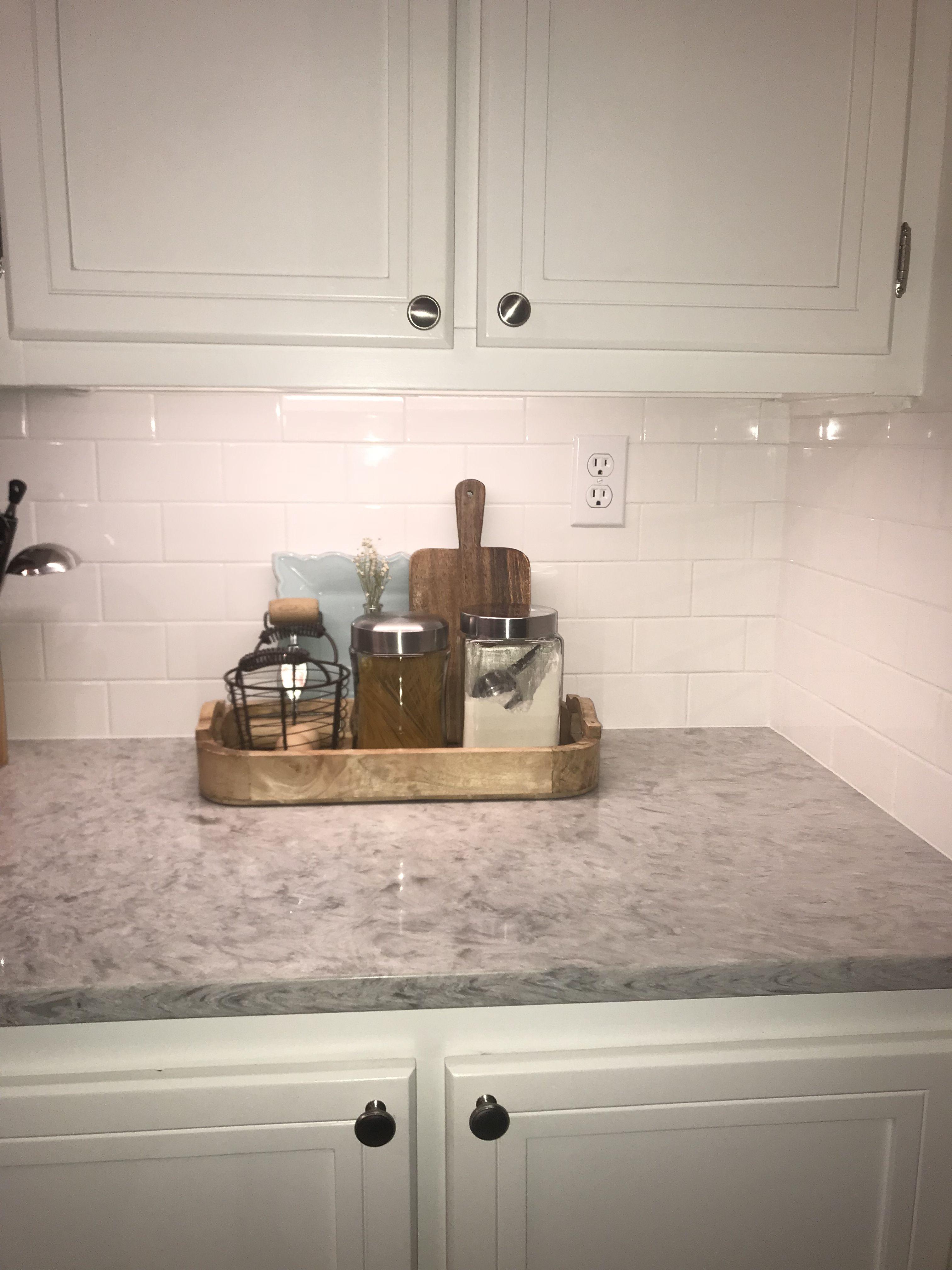Rolling Fog Quartz Countertop And White Subway Tile
