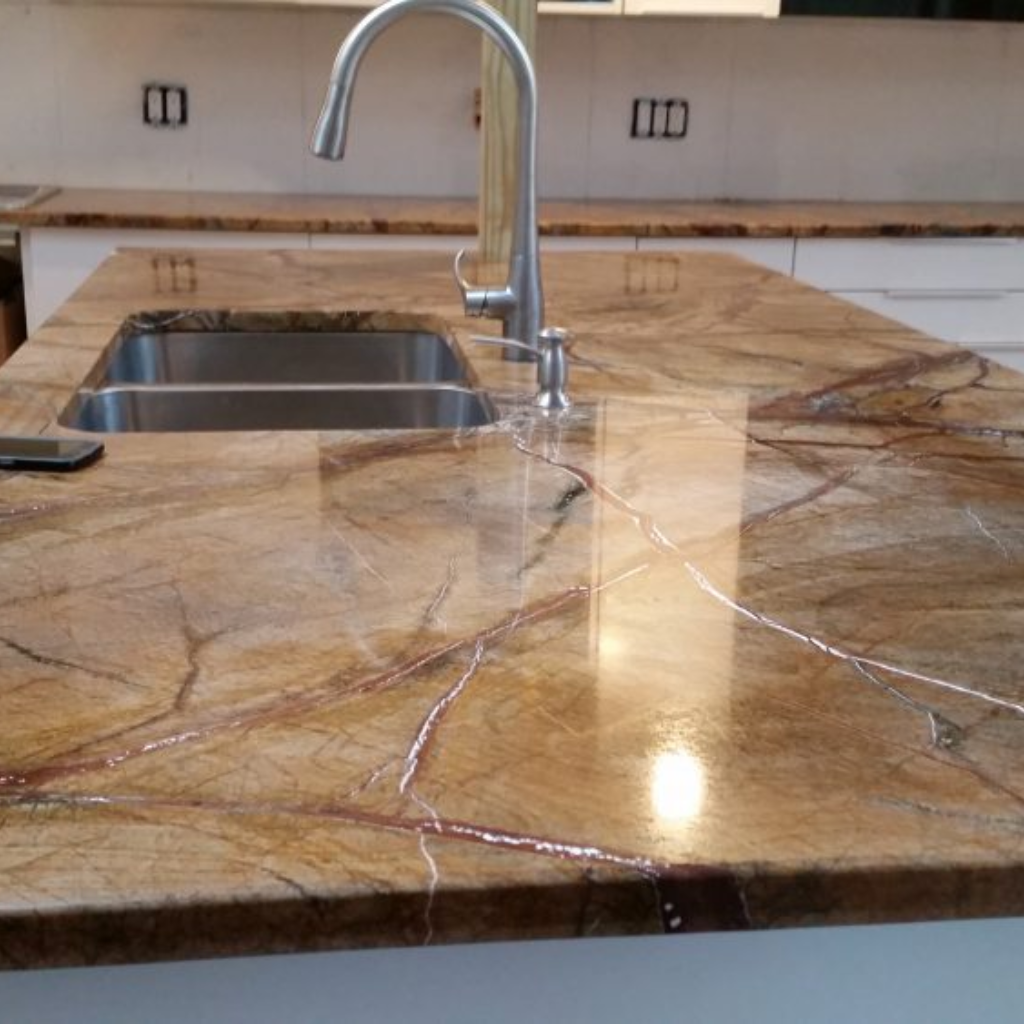 We Ve Recently Installed This Gorgeous Slab Of Rainforest Brown Granite Countertop In Englewood Ne Granite Countertops Brown Granite Brown Granite Countertops