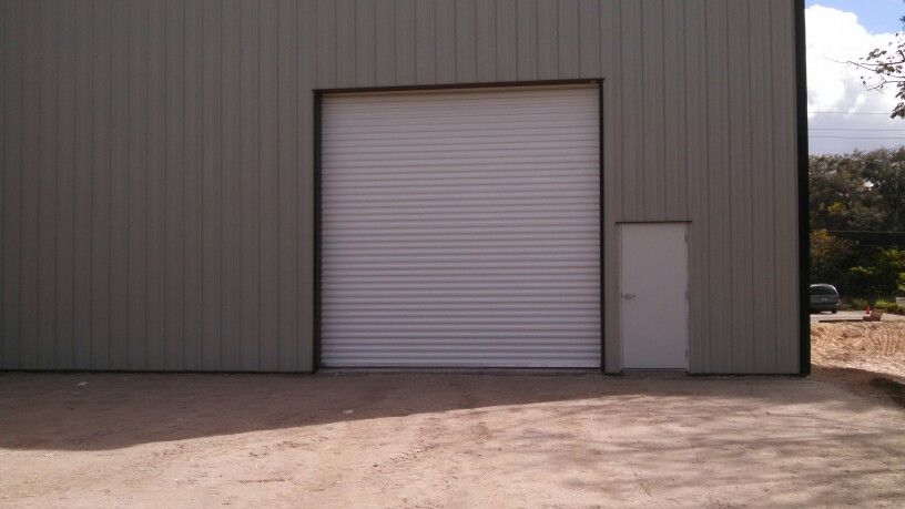 Outside View Of An Overhead Rolling Steel Door At Ashe Glass Mirror In Tampa Fl With Images Rolling Steel Doors Steel Doors Doors