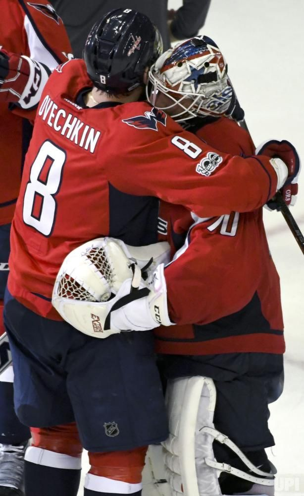 Washington Capitals left wing Alex Ovechkin (8) hugs goalie Braden Holtby  (70) following the game at the Verizon Center in Washington cfb3650f4b18