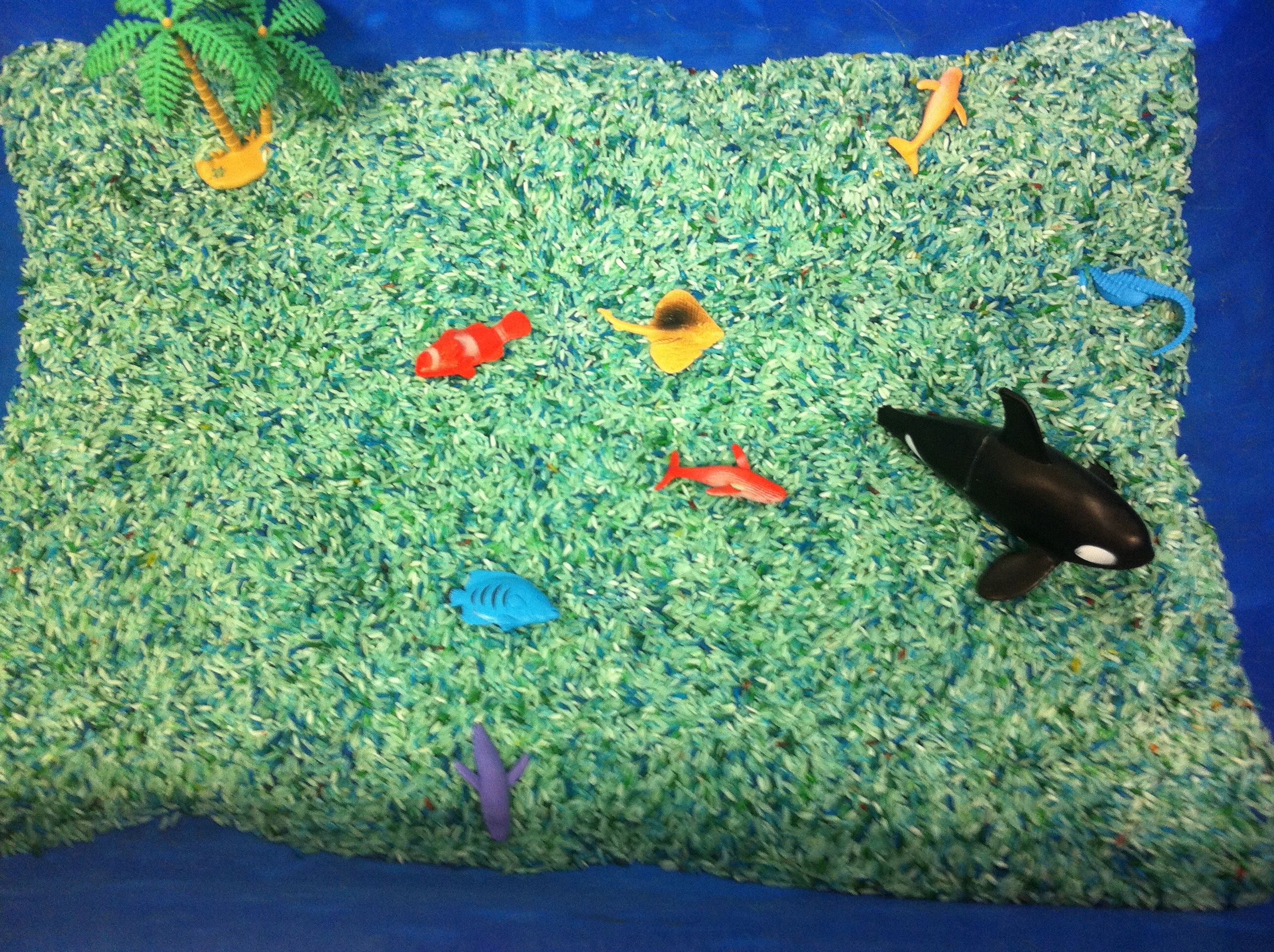 Under the Sea theme sensory bin. I used rice with blue and green ...
