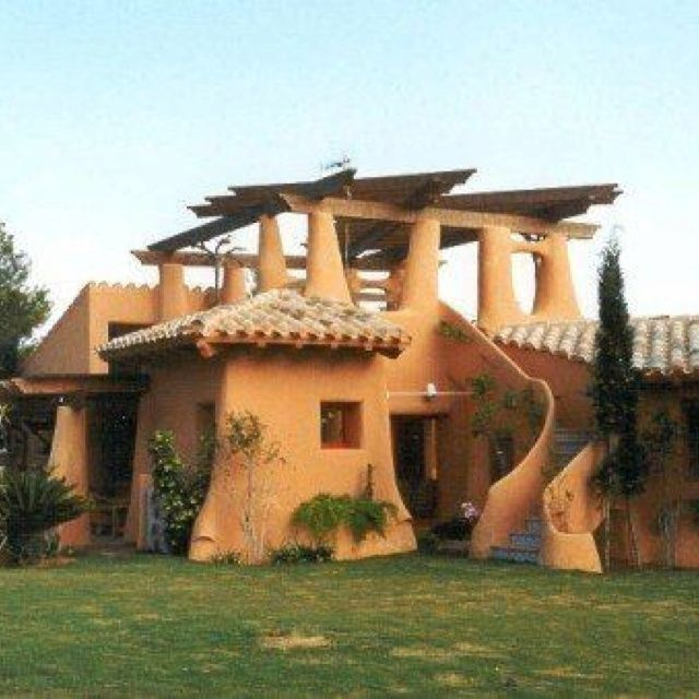 Funky cob home not my style but funky enough to post on my board cobb house ideas - Modern cob and adobe houses ...
