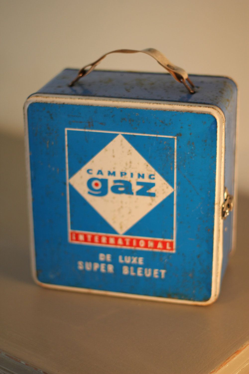 Vintage Camping Gaz Carry Case containing a burner and gas canisters. £35.00, via Etsy.