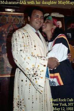 Muhammad Ali with his daughter, wearing robe Elvis Presley gave to him as a gift.
