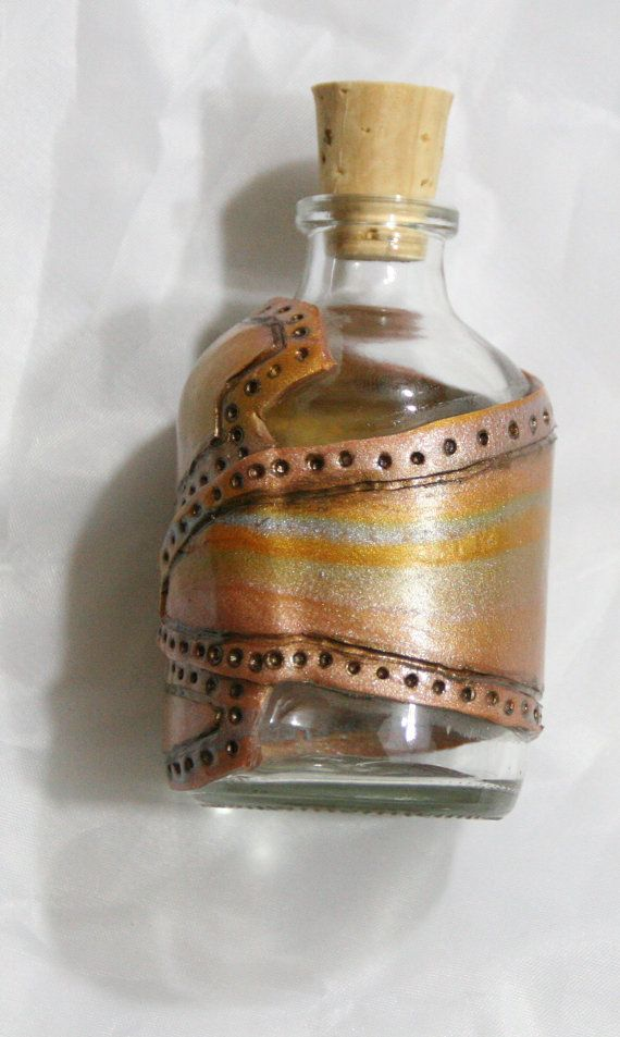 Check out this item in my Etsy shop https://www.etsy.com/listing/458232120/polymer-clay-glass-alchemy-jar-with-cork