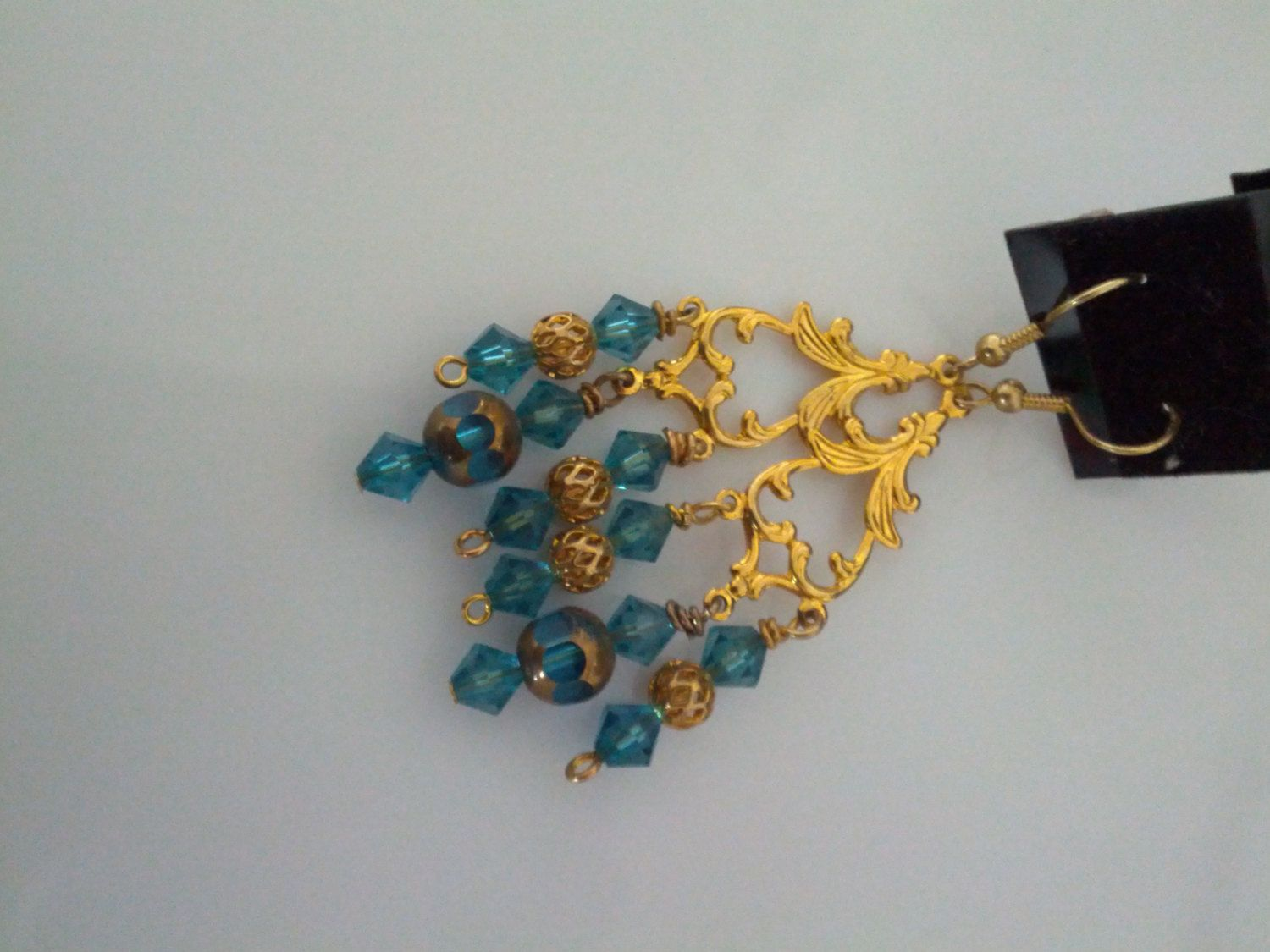 beautiful teal and gold colored beads by crisnohcreations on Etsy